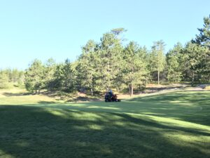 Golf Up North NMU Golf Course Mowing the Greens